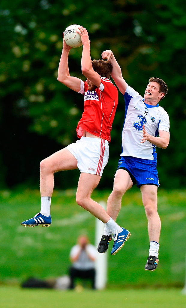 Cork's Michael O'Leary and Waterford's Conor McGrath contend for a high ball. Photo: Matt Browne/Sportsfile