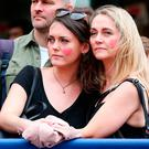 Spectators observe a minute's silence in Manchester. Photo: PA