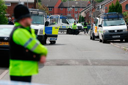 Police activity at a cordon in Selworthy Road near Quantock Street, Moss Side Photo: PA