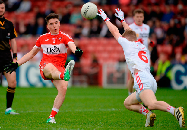 Derry's Conleth McShane in action against Tyrone's Conall Grimes. Photo: Oliver McVeigh/Sportsfile