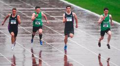 Athletes brave the torrential rain during the 100m in Santry on Saturday. Photo: Eóin Noonan/Sportsfile