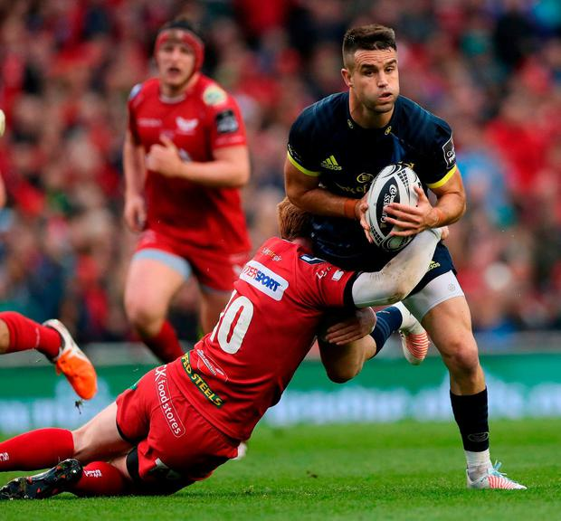 Munsters' Conor Murray and Scarlets' Rhys Patchel. Photo: Brian Lawless/PA Wire