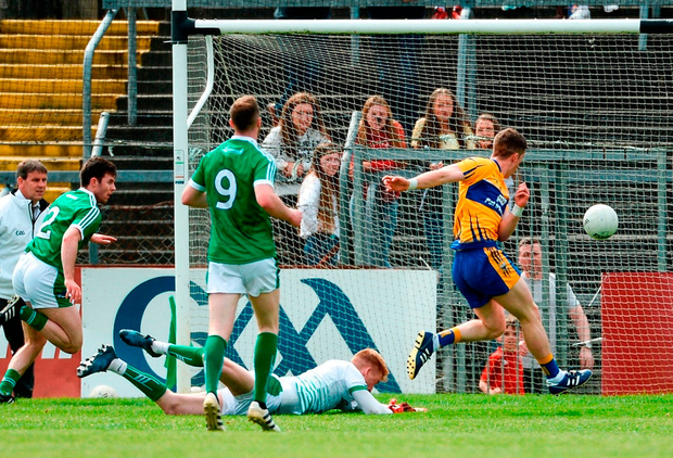 Clare's Eoin Cleary shoots to score his side's first goal past Limerick goalkeeper Donal O'Sullivan. Photo: Diarmuid Greene/Sportsfile