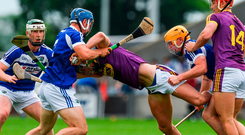 Wexford's Harry Kehoe (centre) has little room to manoeuvre as he is tackled by Lee Cleere and Charles Dwyer of Laois. Photo: Ray McManus/Sportsfile
