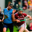 Sean Moran of Dublin is shouldered out over the sideline by Cathal Mannion. Photo: Piaras Ó Mídheach/Sportsfile