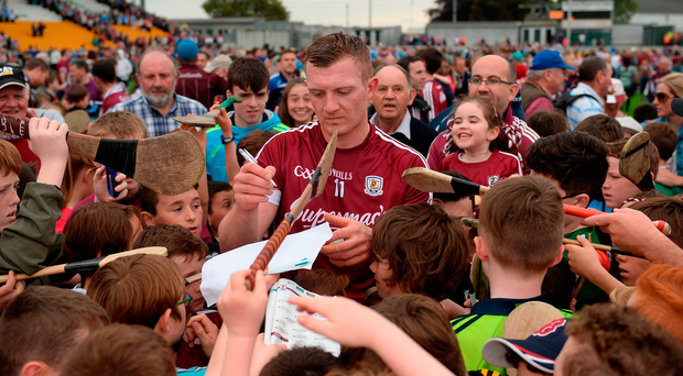 Joe Canning signs autographs for supporters after Galway's victory over Dublin in Tullamore. Photo: Daire Brennan/Sportsfile