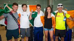 Left to right: Mark and (gold) Paul O'Donovan (silver), Shane O'Driscoll (gold), Denise Walsh (silver), and Gary O'Donovan (silver) arriving home Photo: Doug O'Connor