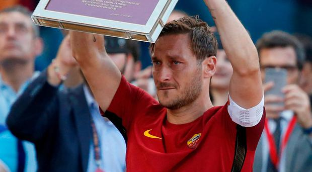 Totti's final match ends in celebration as Roma reaches CL