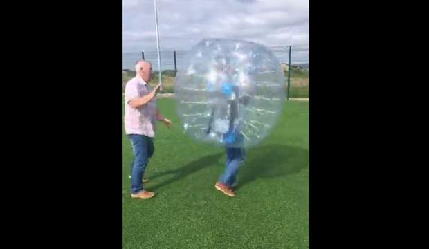 Ryan Tubridy gets spun around in a bumperball