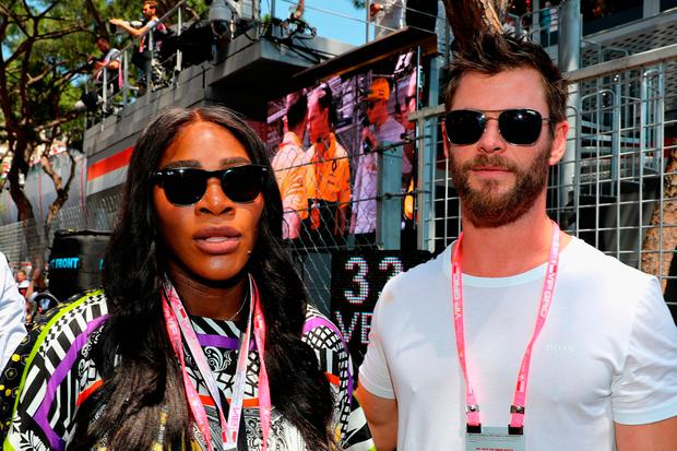 Tennis superstar Serena Williams with actor Chris Hemsworth on the grid during the Monaco Formula One Grand Prix at Circuit de Monaco on May 28, 2017 in Monte-Carlo, Monaco. (Photo by Mark Thompson/Getty Images)