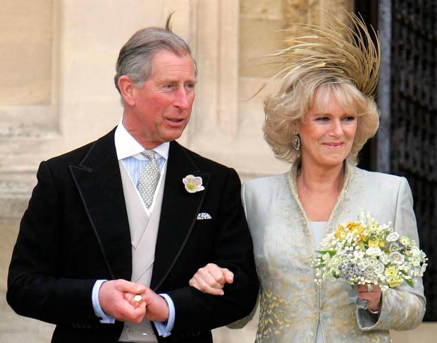 Prince Charles and Camilla, the Duchess of Cornwall leave a blessing at St Georges Chapel in Windsor Castle after their civil wedding 09 April, 2005. (Photo credit should read /AFP/Getty Images)