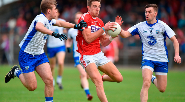 Aidan Walsh of Cork in action against Gavin Crotty, right, and Brian Looby of Waterford