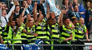 Huddersfield Town celebrate with the trophy