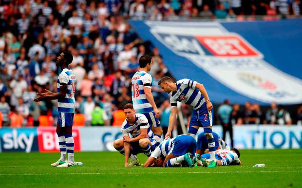Reading's players appear dejected after losing the penalty shoot-out