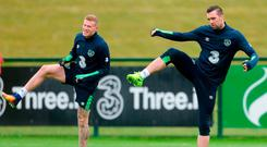 Shane Duffy (right) goes through his stretching routine alongside team-mate James McClean during training in Abbotstown. Photo: Piaras Ó Mídheach/Sportsfile