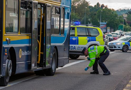 Gardai investigate a road traffic accident involving a Dublin bus and a pedestrian near the Galloping Green pub on the N11. Picture: Arthur Carron