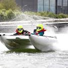 Donnchadh Mac Cobb, of Adventure Training Ireland, and Darinka Montico, of City Kayaking, test out a ThunderCat racing boat in the River Liffey ahead of this weekend's Riverfest. Photograph: Sasko Lazarov / Photocall Ireland