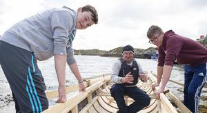 Project participants Marc Cunnane and Niall Coyne with master craftsman Pat Folan