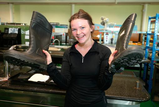 Hazel Byrne, from Killenard, Co Laois, holding a pair of welly boots which were inclded in the auction of the contents of the Central Bank which took place at the Heritage Hotel in Laois. Picture credit; Damien Eagers 30/5/2017