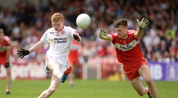 28 May 2017, Peter Og McCartan of Tyrone in action against Dara Rafferty of Derry during the Electric Ireland GAA Ulster GAA Football Minor Championship Quarter-Final game between Derry and Tyrone at Celtic Park, in Derry. Photo by Oliver McVeigh/Sportsfile