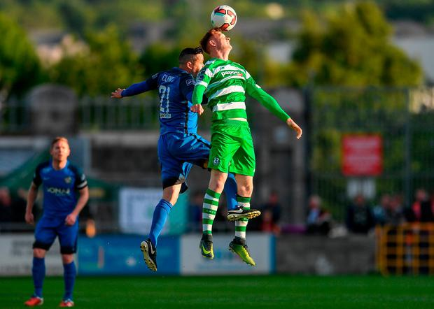 Gary Shaw and Bray's Tim Clancy battle in the air. Photo: Eóin Noonan/Sportsfile