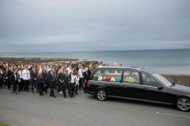 The hearse carrying Jamie McAllister passes the location where his body was recovered after his boat sank in Skerries