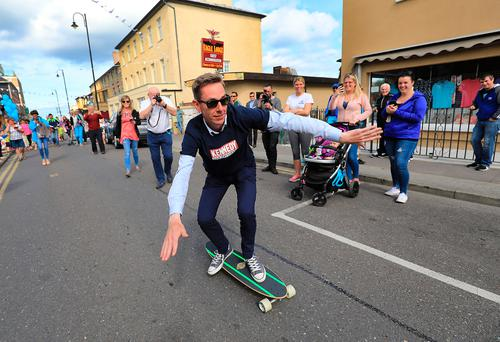 Ryan Tubridy tries out a skateboard presented to him by skateboard maker Barry Liston in Ballybunion, where he was presenting his radio show.Photo: Valerie O'Sullivan