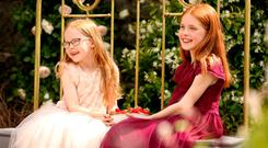 Sisters Olivia (6) and Ellen Foley (8) in 'The Strawberry Bed Garden'. Photo: Gerry Mooney
