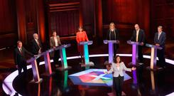 Liberal Democrat leader Tim Farron, Labour Party leader Jeremy Corbyn, Green Party co-leader Caroline Lucas, Plaid Cymru leader Leanne Wood, Interior Minister Amber Rudd, UKIP leader Paul Nuttall, SNP deputy leader Angus Robertson and moderator Mishal Husain attend the BBC's live televised general election debate in Cambridge, Britain, May 31, 2017. Jeff Overs/BBC