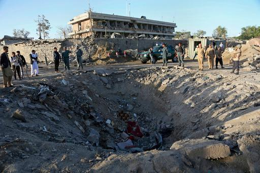 Security forces stand next to a crater created by massive explosion in front of the German Embassy in Kabul, Afghanistan, Wednesday, May 31, 2017. (AP Photo/Rahmat Gul)