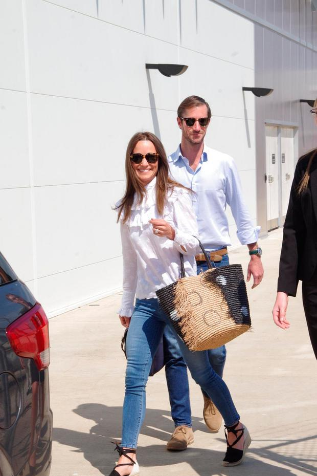 Pippa Middleton and new husband James Matthews arrive in Darwin on the next leg of their multi-stop honeymoon. Picture: MEGA