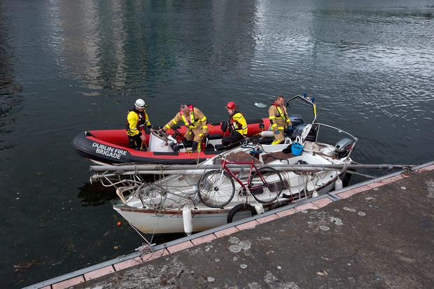 Members of Dublin Fire Brigade River Rescue recover a boat at the scene of incident on The Liffey at Dublin Port. Photo: Tony Gavin