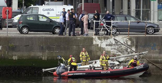 Gardaí speak to one of the men on the quayside (Photo: Tony Gavin)