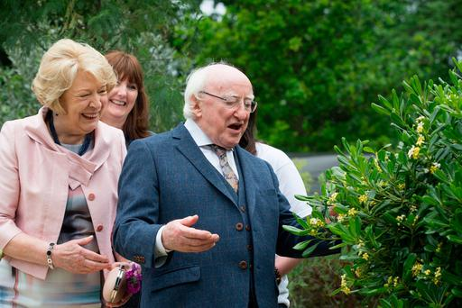 President Michael D Higgins and his wife Sabina with a bee at the opening of Bloom 2017 in the Phoenix Park, Dublin. Pic:Mark Condren 1.6.2017