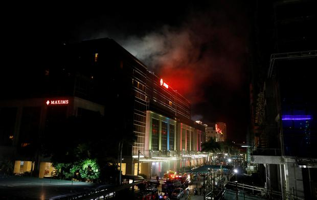 Smoke billows from the Resorts World building in Pasay City, Metro Manila, Philippines June 2, 2017. REUTERS/Erik De Castro