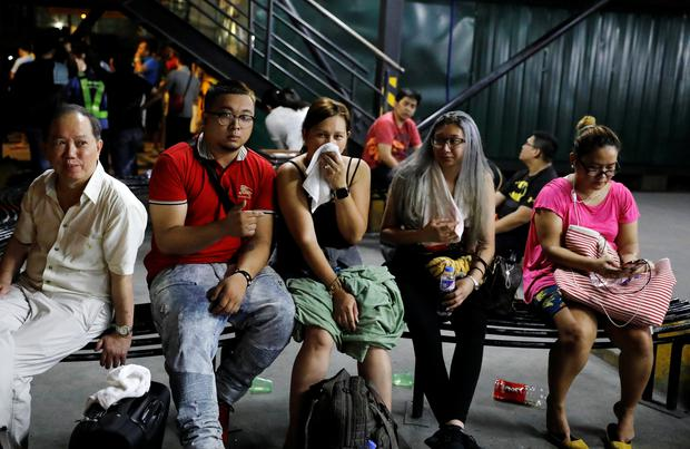 Tourists are pictured after being evacuated from a Resorts World building in Pasay City, Metro Manila, Philippines June 2, 2017. REUTERS/Erik De Castro