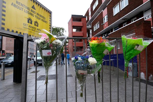 Floral tributes and messages left near the car park in Dorset Street where the gunman struck. Photo: Collins