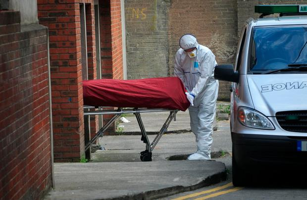 Michael Keogh's body is taken away from the scene by gardai. Photo: Collins