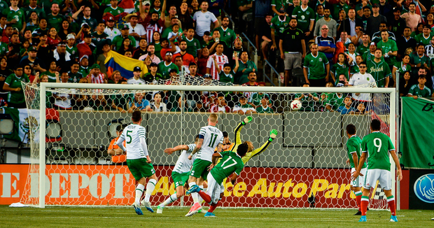 Jesus Corona of Mexico scores his side's first goal