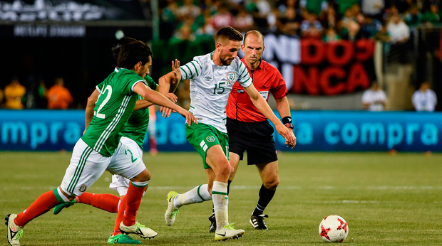 Conor Hourihane of Republic of Ireland in action against Jorge Hernandez of Mexico