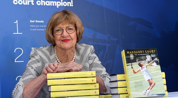 Margaret Court, the former world No.1 and winner of 24 Grand Slam titles poses with her autobiography during day ten of the 2017 Australian Open at Melbourne Park on January 25, 2017 in Melbourne, Australia. (Photo by Vince Caligiuri/Getty Images)