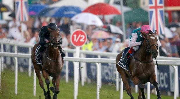 EPSOM, ENGLAND - JUNE 02: Frankie Dettori riding Enable (R) win The Investec Oaks from Rhododendron (L) on Ladies Day at Epsom Racecourse on June 2, 2017 in Epsom, England. (Photo by Alan Crowhurst/Getty Images)