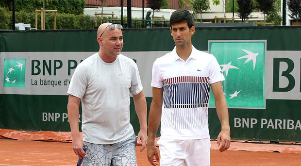 Novak Djokovic of Serbia and his coach Andre Agassi (bald) at practice on day 3 of the 2017 French Open, second Grand Slam of the season at Roland Garros stadium on May 30, 2017 in Paris, France. (Photo by Jean Catuffe/Getty Images)