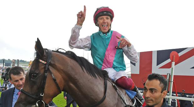 Frankie Dettori, riding Enable, celebrates winning the Investec Oaks race during Ladies Day of the 2017 Investec Derby Festival at The Jockey Club's Epsom Downs Racecourse at Epsom Racecourse on June 2, 2017 in Epsom, England. (Photo by David M Benett/Dave Benett/Getty Images for The Jockey Club)