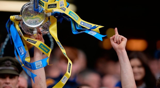 Cathal Barrett of Tipperary lifts the trophy following his team's victory in the GAA Hurling All-Ireland Senior Championship Final match between Kilkenny and Tipperary at Croke Park in Dublin. Photo by Seb Daly/Sportsfile
