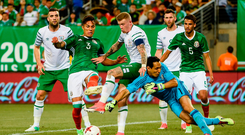 James McClean gets caught in the middle of the Mexican duo Carlos Salcedo (L) and Rodolfo Cota at the MetLife Stadium in New Jersey, USA. Photo by David Maher/Sportsfile