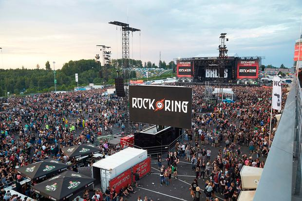 Visitors leave the music festival Rock am Ring outside the western town of Nuerburg, Germany, Friday, June 2, 2017. German authorities have shut down a popular rock music festival because of a possible terrorist threat. (Thomas Frey/Dpa via AP)