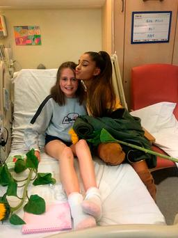 Family handout photo of Ariana Grande meeting Evie Mills as the American singer visited young fans at the Royal Manchester Children's Hospital ward who were injured in the Manchester terror attack. Karen Mills/PA Wire