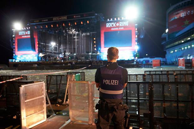 A policeman guards the area near the main stage of the rock festival 'Rock am Ring' near Nuerburg, Germany, early Saturday, June 3, 2017. (Thomas Frey/dpa via AP)