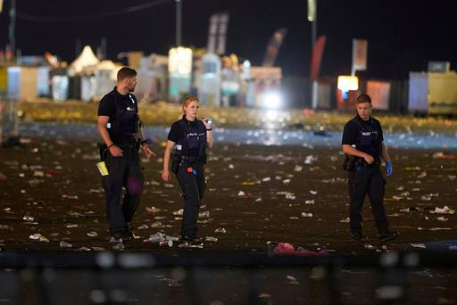 Police search the area near the main stage of the rock festival 'Rock am Ring' near Nuerburg, Germany, early Saturday, June 3, 2017. (Thomas Frey/dpa via AP)